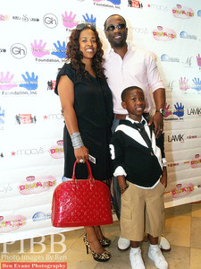 """Singer """"Q"""" Parker of the Group 112 and his wife Sharlinda Rowe-Parker, and their son Lil """"Q"""" a.k.a Quinnes Jr."""