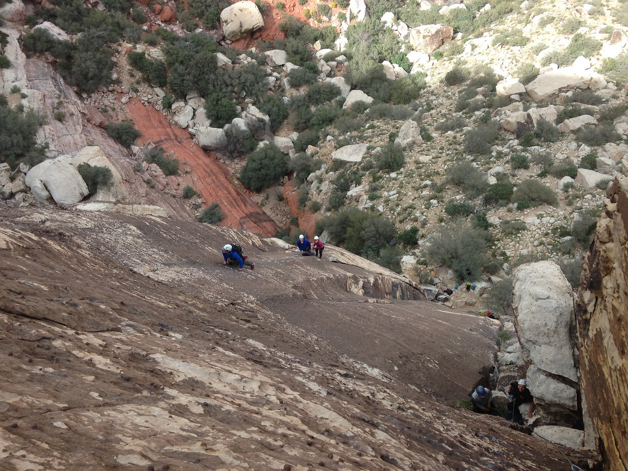 Looking down Lotta Balls Wall.  Tryhardral on the right, Lotta Balls on the left.  AAI guide Chad leading on the left.