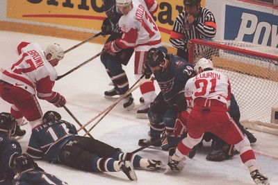 The Washington Capitals defence smothers Detroit Red Wings Sergei Fedorov (91) and Doug Brown (17) has his shot blocked early in the first period during game 2 of the Stanley Cup.