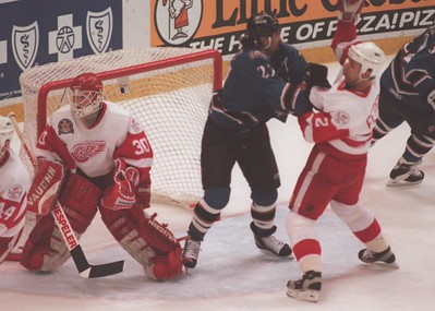 Detroit Red Wings Viacheslav Fetisov (2) and Craig Berube (27) of the Washinbgton Capitals battle for position in from od the Detroit goal during game 2 of the Stanley Cup.