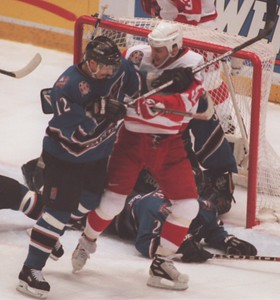 Detroit Red Wing Sergei Fedorov (91) battles for position wioth Washington Capitals Peter Bondra (12) in front ofthe Capitals net early in the first period during the game 2 of the Stanley Cup.