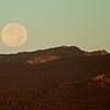 Full moon setting over Paulina Peak
