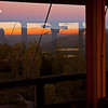 Multiple reflections going on here: the imminent sunrise in the east and the Osborne Fire-Finder are reflected in the lookout window, while the setting full moon (above the Newberry Volcano rim) and China Hat Butte are visible through that window.