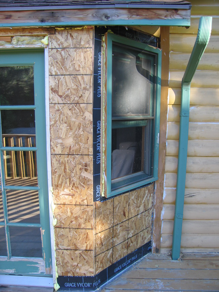 July 27, 2005 - A crew came in and replaced the water damaged studs and rehung the window...siding to follow