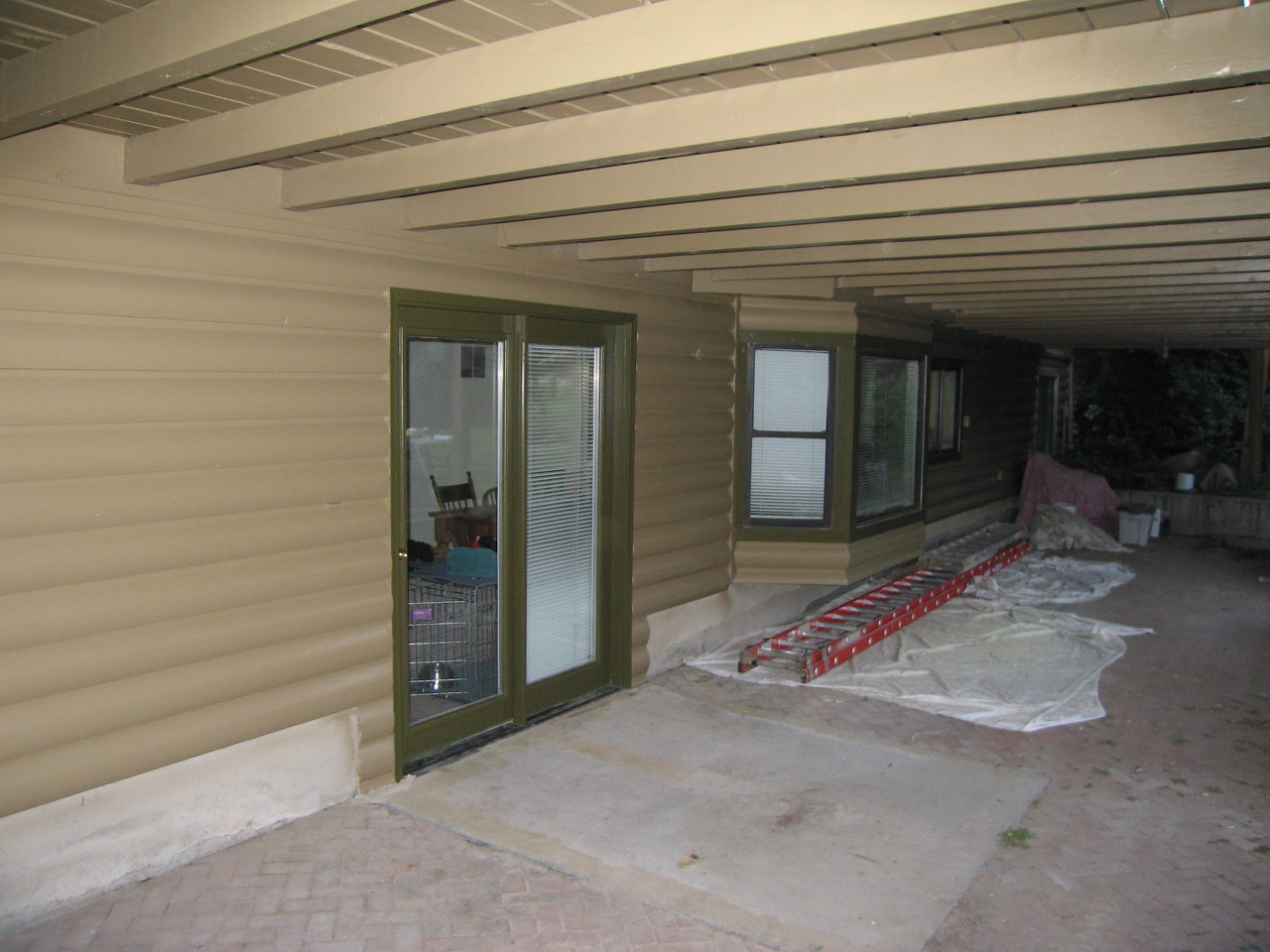 A view of the basement patio, under the deck