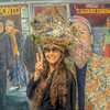 Janee with live dove in hat-cage in front of painting of Mark Kornfeld by Barbara Mastej