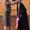 Kathy Kerns places the stole over Renee.