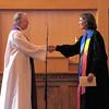 Wayne Arnason offeres the Right Hand of Fellowship