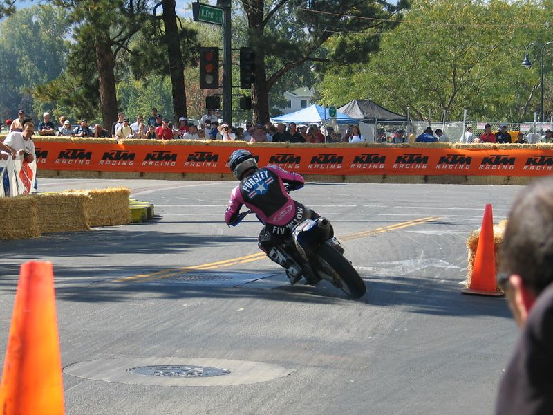 The technique of choice was to downshift twice while braking hard enough to slide the rear tire, getting the bike sideways on the brakes, then accelerating through the start/finish line.