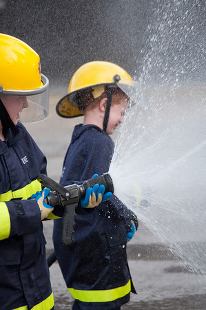 Eoin & Jack Metcalfe get in some hose practise during a vidit to Northern Ireland Fire & Rescue Training School