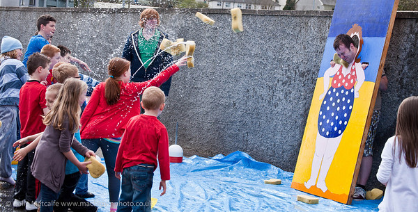 A willing volunteer takes to the stocks for charity at Ballymena Methodist Church's Fun Day