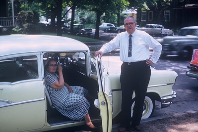 My grandfather and grandmother and their new, 1957 Chevy.  I wish we still had that car too.  :)