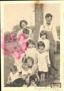 This is a scan of the original photo of the Stearn Family provided by Connie Clark.  The red stain and folds in the picture were the challenges in this photo.  See next slide for 1st attempt at the restoration.  Connie's mom Betty is in the photo.  I made the assumption that this was the Clark Family, but it was Betty's siblings and parents, The Stearns.