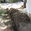 Avoiding buried utilities that were put in last year.  BUT uncovered original drain put in by Mike and Chris (in 1990)?