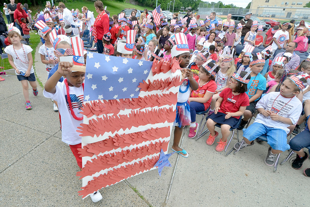 ". Mike McMahon - The Record ,  Kindergarden student carry a flag constructed of hands at Troy\'s School 14 celebrate ""Red, White and Blue\"" day to honor the flag and patriotism,  Friday June 6, 2014"
