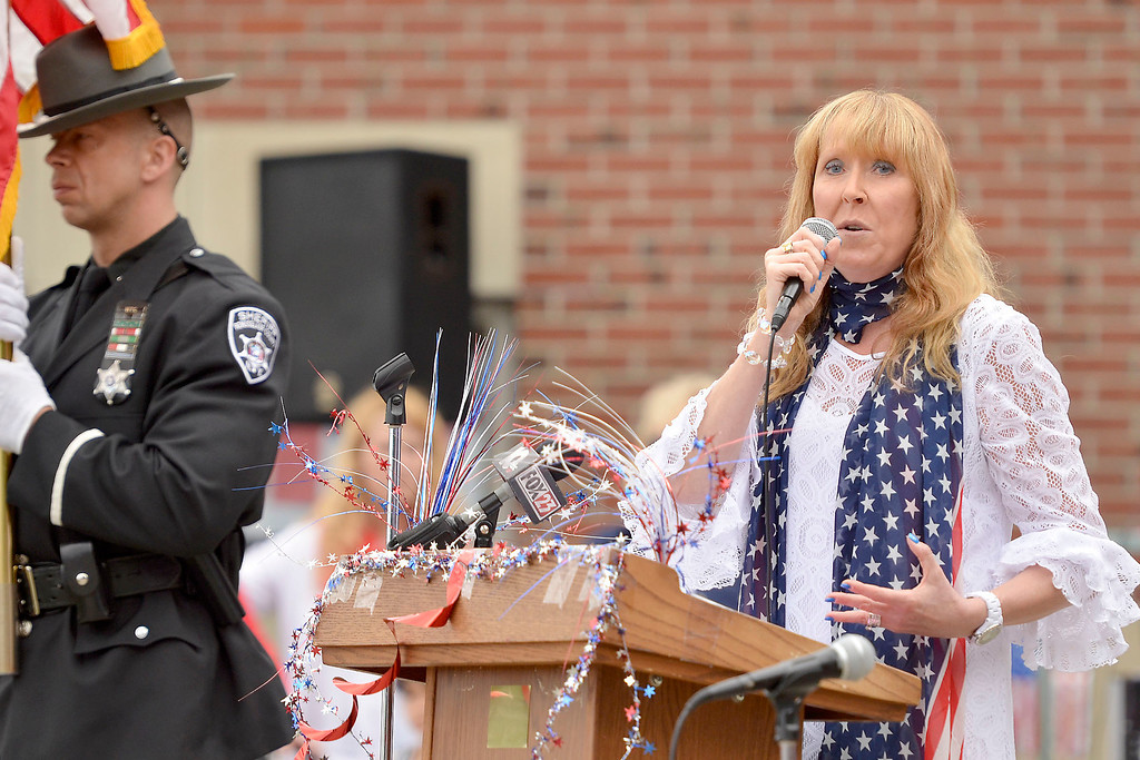". Mike McMahon - The Record ,  School 14 Principal Karen Cloutier at Troy\'s School 14 celebrate ""Red, White and Blue\"" day to honor the flag and patriotism,  Friday June 6, 2014"