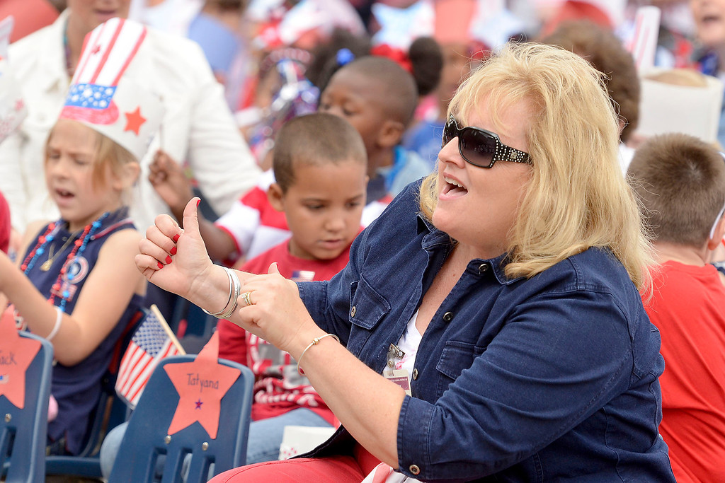 ". Mike McMahon - The Record ,  Teacher Patty Weaver-Lipscomb directs the singing of ""I Love America\"" Troy\'s School 14 celebrate \""Red, White and Blue\"" day to honor the flag and patriotism,  Friday June 6, 2014"