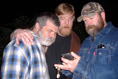 Harlan, Dug, and Eric with new I-phone at bonfire Friday in Gurneville.