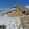 A gathering at the summit of Imogene Pass in Colorado before traversing a snowy treacherous path.