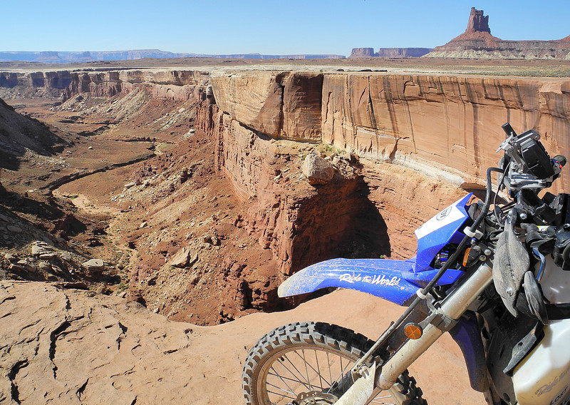A rider dares to ride close to the edge of the White Rim Canyon in Canyonlands National Park, Utah edit