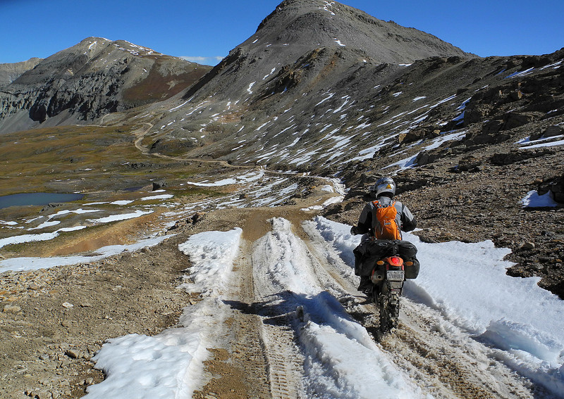 Riding through summer snow on Black Bear Pass in Colorado.