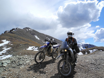 Riders take in the view at Hurricane Pass, Colorado.