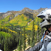 A rider appreciates the fall colors in Colorado.