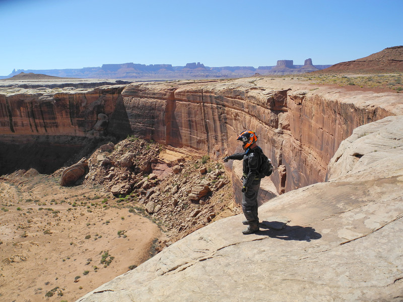 A rider looks over the White Rim Canyon in Canyonlands National Park, Utah
