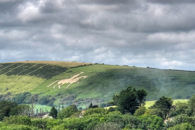 The Osmington White Horse.<br /> <br /> Carved in 1808 into the limestone hillside it is a likeness of a mounted<br /> King George III who was a benefactor to nearby Weymouth and there<br /> became the first monarch to bathe in public in the sea.