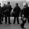 Teenie Harris walks behind the wall of policemen.