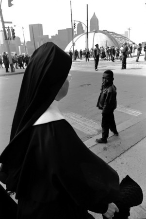 A nun looks out at the then Civic Arena from the area of the Church of the Epiphany.