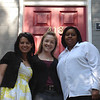 Erin Saiz Hanna, Aisha S. Taylor and Maria A. Noel stand outside the front door of the new office of the Women's Ordination Conference in Washington, DC on May 28, 2008.