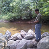 Jim Holland inspects the existing shallow river.