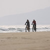 Tourists bike along the coast of Riyuewan.