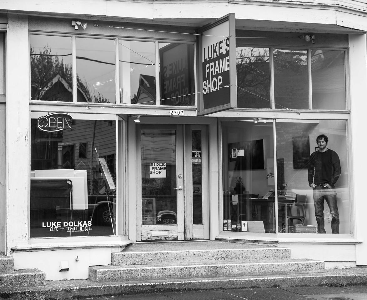 Luke's Frame Shop with Luke in Window