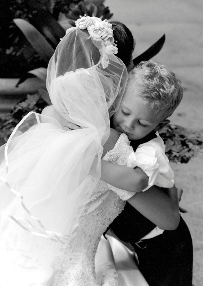Litttle Boy Hugs Bride