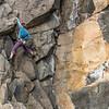 Kat Vollinger climbing Kennedy's Crack (17). The Pinnacle Sunnyside, Long Beach, Dunedin.