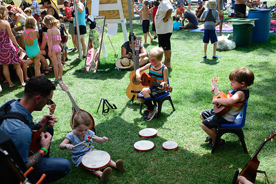 Little pickers try instruments at the 2016 Rockygrass Festival. Photo by Candace Horgan.