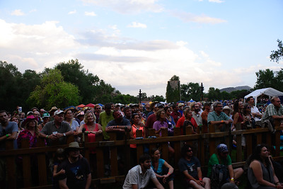 Fans enjoy Rockygrass under a later summer evening sky. Photo by Candace Horgan.