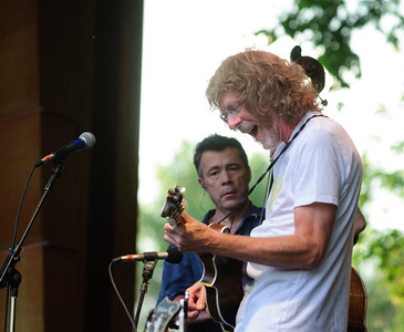 Sam Bush jams while Edgar Meyer looks on at the 44th annual Rockygrass. Photo by Candace Horgan.