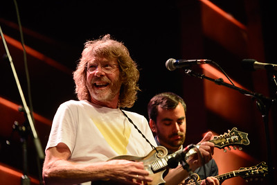Sam Bush sits in with Steep Canyon Rangets as Mike Guggino looke on wt the 44th annual Rockygrass. Photo by Candace Horgan.