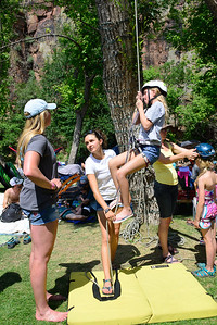 A young festivarian tries rope climbing at the 44th annual Rockygrass. Photo by Candace Horgan.