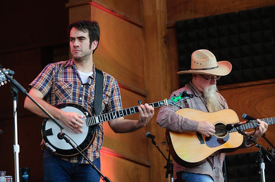 Noam Pikelny (L) and David Grier play with Tim O'Brien on day one of the 44th annual Rockygrass.