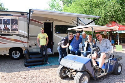Four instructor of the Artistworks Academy of Bluegrass in front of the ArtistWorks camper. (From L-R): Michael Daves (in black shirt), Mike Marshall, Darol Anger, and Tony Trischka. Photo by Candace Horgan.