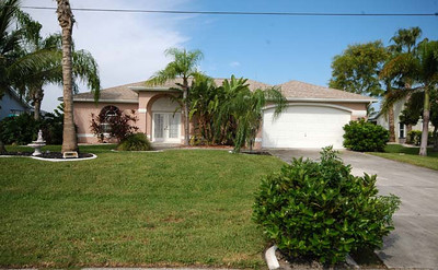 Cape Coral Homes For Sale, Presented by Roland Theis P.A. SW 25th Pl. Cape Coral, Florida