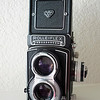 This beautiful Rolleiflex T1 camera is for sale! Please contact me at mulhollandengel at gmail dot come for more info!<br /> <br /> Specs: Rolleflex T1. Model K8 T1<br /> October 1958 - June 1961, 56,000 pieces<br /> Serials: T2.100.00 - T2.155.999<br /> <br /> Taking Lens:<br /> Tessar 3,5/75mm, by Zeiss Oberkochen, Bayonet 1<br /> Finder lens:<br /> Zeiss Heidosmat 2,8/75mm, Bayonet 1<br /> <br /> Shutter:<br /> Synchro Compur MXV, 1 - 1/500 sec., B, X-sync., self timer.<br /> Film: 120 for 12 exp. 6x6, also (from # 2.151.000 only) 16 exp. 4.5x6<br /> or 4x4 and  35mm adapter Rolleikin 2. Special order: taking 220 film<br /> for 12 or 24 exposures.<br /> Film Transportation: winding lever, film marker in film chamber,<br /> exposure counter for exposures 1-12. Blank film pressure plate.<br /> Can come with or without built on  exposure metering. (This one HAS the meter!)<br /> Dimensions: 11.2x9.7x17.8cm.<br /> Weight: 1,020 grams.