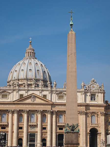 A portrait of Basilica San Pietro and the obelisk in St Peter's Square.