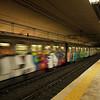 A riot of colour as a graffiti strewn train exits Coloseo Metro Station.