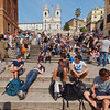 Tourists resting on the Spanish Steps.