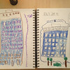 """Boys sat outside and looked at our building and drew """"home""""."""
